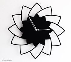 Metal wall clock laser cut. Black matt powder coating painted. Silent Precision quartz movement made in Germany. Design Jacques Lahitte © Tolonensis Creation www.tolonensis.com
