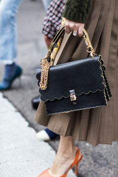 Spotted at Milan Fashion Week - Fendi's covetable scallop-edge Kan I bag.