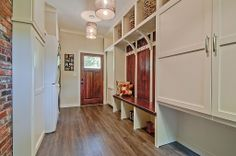 Modern Mud Room - Find more amazing designs on Zillow Digs!  Corbels a nice touch.  Oversized upper cubbies.  Nice touch.