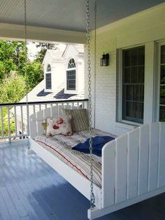 twin size white swing bed on porch