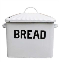 White enamel over metal old school bread box with handled lid. Clearly states the contents in black lettering. Put it in a place of honor and then stop to thank your great grandmother at whose house y
