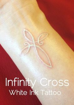 On hand wrist, a White Ink Tattoo of an Infinity Cross Actually thinking about getting a small white tattoo
