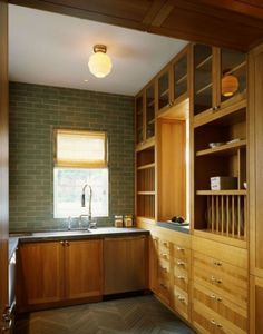 What is there not to love in this kitchen? The subway tile just the right shade of green, that amazing light fixture (I like 'em simple), and the cupboards. Oh, the cupboards.
