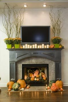 not crazy about the mantle but I love the idea of turning the fire place into a pumpkin patch!