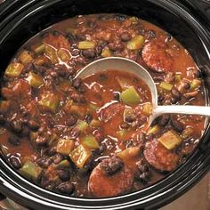 "Yum Creole Black Beans 'n' Sausage Recipe - ""I brown the meat, cut up veggies and measure spices the night before, and then assemble and start it cooking the next morning. ""when I get home, I make the rice…and dinner is served! Creole Recipes, Cajun Recipes, Bean Recipes, Soup Recipes, Smoked Sausage Recipes, Creole Cooking, Cajun Cooking, Crock Pot Cooking, Cajun Food"