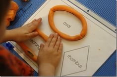 Use Play-Doh to trace the shapes in the sheet protector