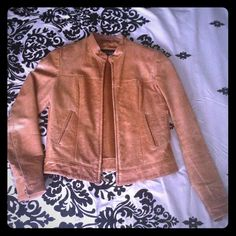 Genuine leather jacket Brown color genuine leather jacket inn pre-loved condition. I've had this since early 2000s so I guess it's vintage condition. Very loved and worn many times, shows signs of wear on the elbows (fading) and has some scratches throughout. The flaws give this jacket a nice vintage vibe 😊 I can provide more pics on demand of interested. Size medium but fits more like a Small therefore I listed as small. If concerned about flaws pls ask questions or for more pics prior to…