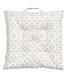 Check this out! Seat cushion in woven cotton fabric with a printed pattern. Handle at one side and polyester fill. Thickness 1 1/2 in. - Visit hm.com to see more.