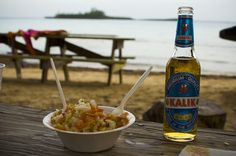 Fresh conch salad and cold Kalik Cool off with a bowl of fresh Bahamian conch salad and a cold Kalik beer while listening to the waves and burying your feet in the sand in the Bahamas.