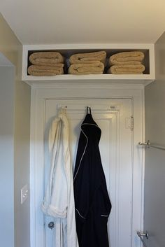 Add a shelf over your door to store your towels.