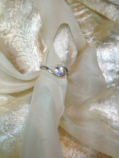 Hey, I found this really awesome Etsy listing at https://www.etsy.com/listing/173144342/swirl-engagement-ring-rainbow-moonstone