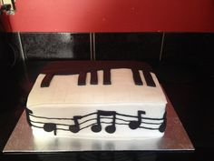 Piano cake...chocolate cake fill with buttercream covered in buttercream and marshmallow and buttercream fondant made by me Danielle McLeod at Sugared Dreams Cakes & Bakes #pianocake #musicloverscake