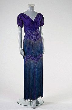 early Mainbocher purple satin-backed crepe evening gown, 1930s, labelled `12 Avenue George V, Paris', fringed in silver-blue cord