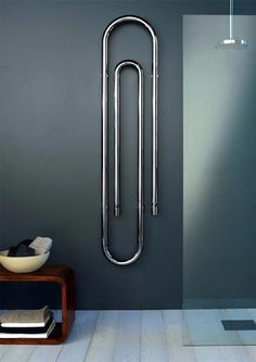 Towel warmer shaped like a paper clip. Cool art looking piece, but not sure how towels would hang well on this one.