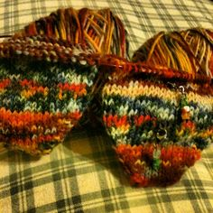 2 at a time, toe up socks, on one circular needle, with self pattering yarn.