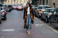 Gilda Ambrosio wearing a brown black fur coat, denim jeans, white tshirt outside Alberta Ferretti on February 22, 2017 in Milan, Italy.