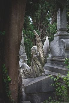 As she watches over you.. cemetery sculpture angel