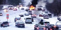 10 Crazy Photos Of North Carolina Crippled by Snow [Except for this one, with the car on fire, these photos could have been taken in Atlanta two weeks ago. Hang in there, it gets better.]