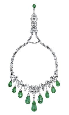 AN ART DECO EMERALD AND DIAMOND NECKLACE, BY VAN CLEEF & ARPELS  The baguette-cut and epaulet-shaped diamond neckchain enhanced by pavé-set diamond scalopped links, suspending at the front a fringe of nine graduated drop-shaped emeralds with baguette-cut diamond line surmounts, alternated with rectangular-cut diamond collets, to the pendant clasp with drop-shaped emerald terminal, 1929,  By Van Cleef & Arpels, no. 46.377