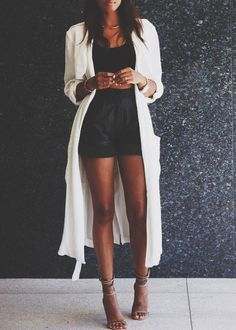 long white cardigan + black crop top + high waist shorts