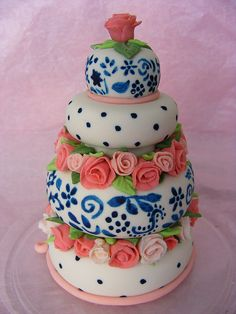this design is so cool - I love the painted blue patterns mixed in w/ the roses.
