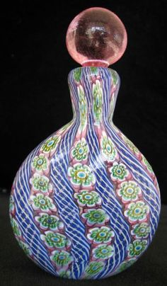 Murano Art Glass Millefiori Perfume Bottle. This is a vintage bottle from 1930's or 1940's. Base of the bottle is purple, blue, pink, green & red millefiore with latticing between.