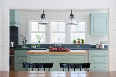 farmhouse kitchen by Rafe Churchill: Traditional Houses --Cabinet paint: Blue Green, Farrow & Ball; pendant lights: PW Vintage Lighting