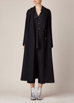 Draped asymmetrical button up shirt in black silk crepe de chine. Dry clean.