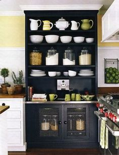 29 Insanely Clever Kitchen Ideas ~ Even a big jar of flour looks good with the right presentation. That's why this built in cabinet looks so fab. The beauty of this piece is that it's been planned from the beginning - even the cornice wraps around - so it's important to get a professional to help you with this one.