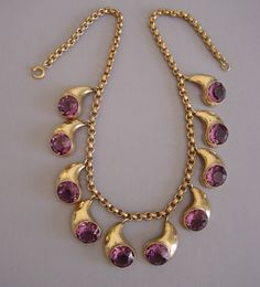 Purple teardrop necklace with unfoiled rhinestones set in gold tone - 1930