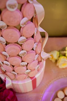 Here we have something new, macaron towers made out of pink macarons and tiny sugar bees hand painted in 22k gold!