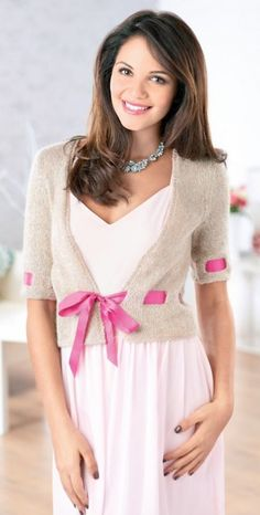 Sparkly Cardigan - Add a touch of sparkle to a simple cardigan with Sian Brown's easy-to-knit cardigan in a value yarn with ribbon detailing for added ladylike elegance.