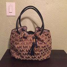 NWT Michael Kors bag NWT Michael Kors bag in a tan with a dark brown logo. The straps are a dark blue and it has the MK emblem. Great bag to carry everything in, no trades. Please don't comment your offers use the offer button, thanks! Michael Kors Bags