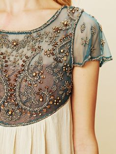 tambour beading a dress | The use of netting as a base for beading is a common effect. In ... rayban,cheap rayban glasses