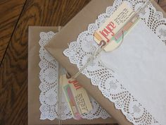 good idea for wrapping books.  You can probably get the paper doilies at the dollar store.