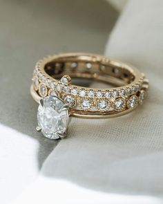 We think a mix of shapes and textures make the perfect engagement ring stack. Here we have the Laurel with an oval diamond, the Folio Band with bezel set diamonds and milgrain texture and the Snowflake band. Unique and stunning. Handmade Engagement Rings, Perfect Engagement Ring, Oval Diamond, Diamond Bands, Custom Wedding Rings, Rings For Men, Diamonds, White Gold, Rose Gold