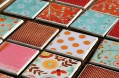 make your own coasters with 4x4 tiles & 4x4 scrapbook paper! then put mod podge on tiles and let it dry! spray a coat of clear spray paint! finally attach felt pads to the buttom!!