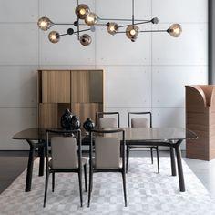 Memos table, Ibla chairs, Lia storage unit