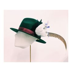 Cecile Millinery, forest green rabbit fur hat with feathers. Hand made in London