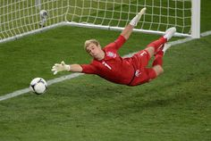 English goalkeeper Joe Hart dives during the Euro 2012 soccer championships quarterfinal match betweem England and Italy on June 24 at the Olympic Stadium in Kiev. Italy won in a shootout. (Jeff Pachoud/AFP/Getty Images) #
