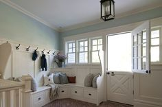 Cozy mudroom complete with fluffy pillows, herringbone floor and a dutch door. #Idie