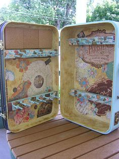 Suitcase turned jewelry display.   This is a good idea to set up a little display at work, etc.