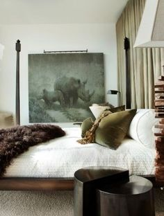 Masculine Bedroom with Four Poster Bed, Faux Fur Blanket, Velvet Pillow, and Vintage Oil Painting.