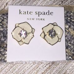 New Kate Spade N. York White cream Flower earrings Brand new with tags. Kate Spade New York. Cream Flower earrings with gorgeous rhinestone studs in the middle. 14k gold filled. Authentic. kate spade Jewelry Earrings