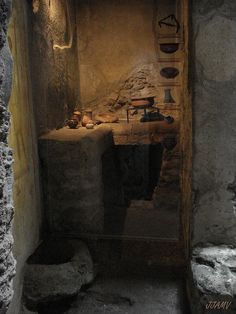 small kitchen Pompeii 79AD | kitchen with cooking utensils. A tripod with cauldron can still be seen in the fireplace, as well as an assortment of pots