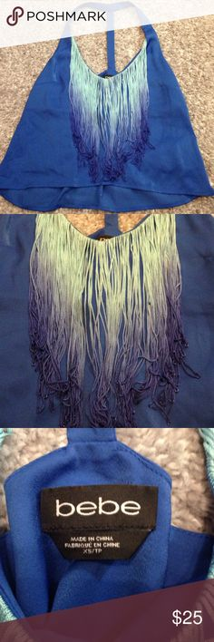 BEBE fringe top BEBE blue top with light to dark blue ombré fringe. The top was never worn but tags were taken off. It is not a crop top but meant to meet top hemline of pants/shorts. Size XS.  Super soft and comfortable!  (Last image shown with matching shorts that are sold separately-see other closet listing for shorts.) bebe Tops Tank Tops