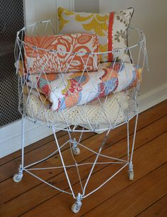 Ive been looking for one forever. My grandma had one when i was little. vintage wire laundry basket - perfect for blanket storage