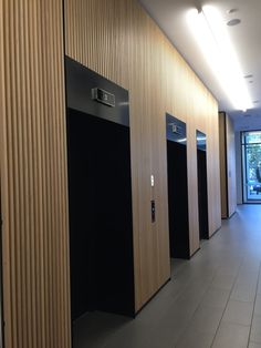 Photo 2: timber cladding in this lift area looks lovely and modern and protects…
