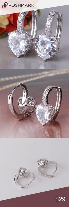 18k heart earrings Brand new. 18 whit gold filled heart shaped earrings. Stunning leverback. Comes with box. Price is firm Jewelry Earrings