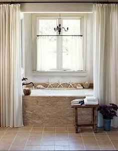 See our favorite white bathrooms and browse through our favorite white bathroom pictures, including white bathroom furniture, white decor and more. Bathroom Windows In Shower, Window In Shower, Shower Curtains, Bathroom Curtains, Stone Bathroom, Window Curtains, Bath Window, Modern Bathroom, Linen Curtains